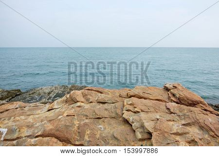Scene of cliff with seascape view at Khao Laem Ya Mu Ko Samet National Park in the Gulf of Thailand.
