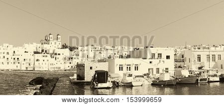 Graphic Naoussa's port at Paros island in Greece in old retro colors. A famous touristic destination.