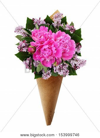 Bouquet of pink peonies and lilac flowers in a craft paper cornet isolated on white