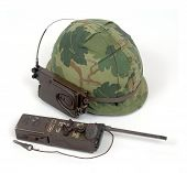 American Vietnam period M1 pattern GI helmet with squad level radio receiver AN/PRR-9 and transmitter AN/PRT-4A. poster