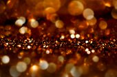 Dark Gold Festive blur background. Abstract night twinkled bright background with bokeh defocused golden lights. Christmas blurry boke lights poster