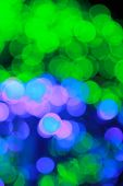 Abstract defocused lights bokeh vertical background blue and green colors poster