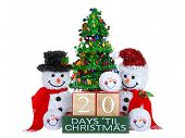 20 Days until Christmas light beech wood blocks with red trim on a green base with tinsel christmas tree mr and mrs snowman and snowball snowmen heads isolated on a white background. poster
