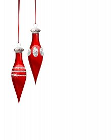 Red Christmas ornaments on white background with space for text.