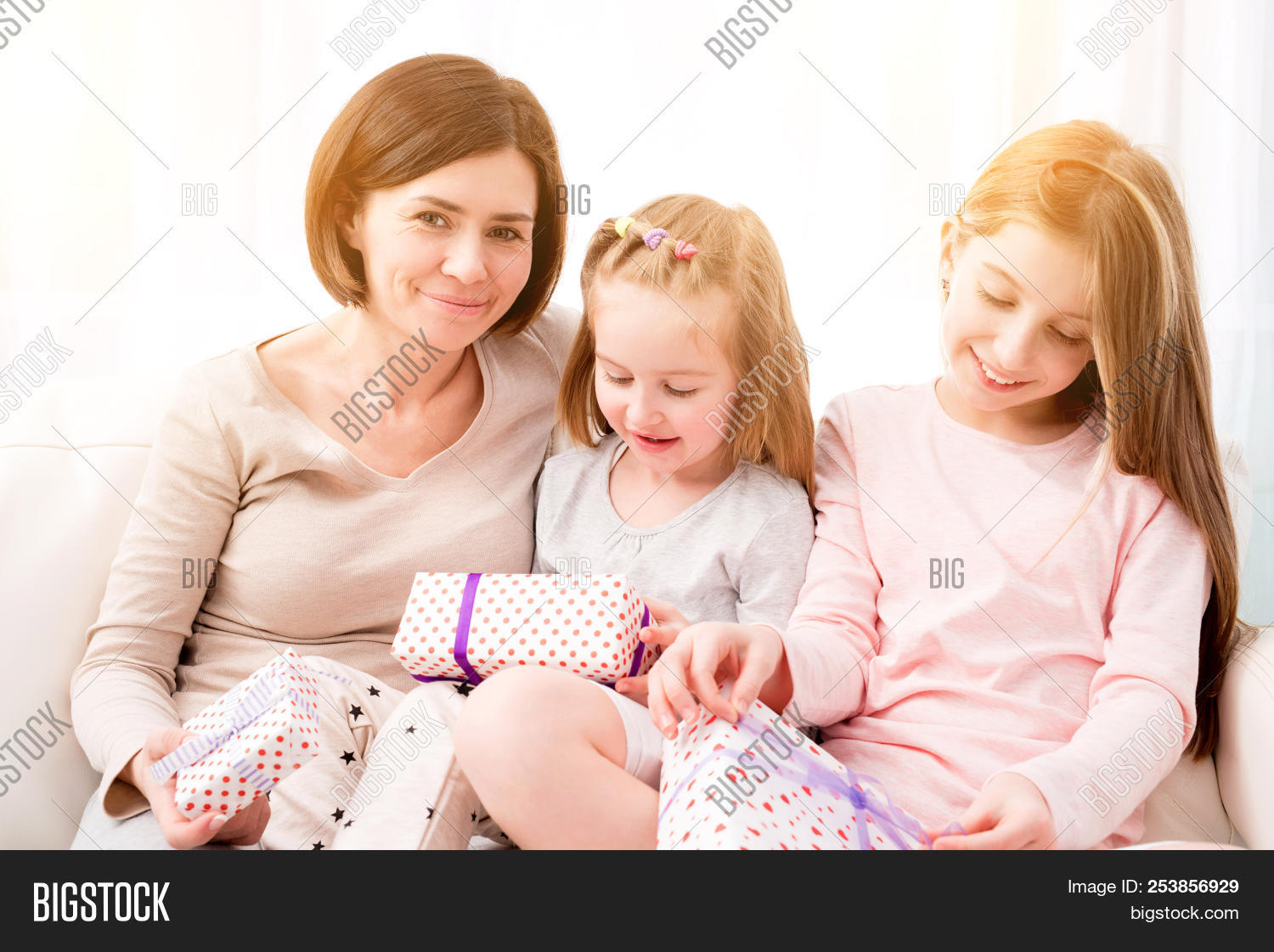 Cheerful Mom And Her Beautiful Daughters Exchanging Gifts Happy Birthday Womans Day