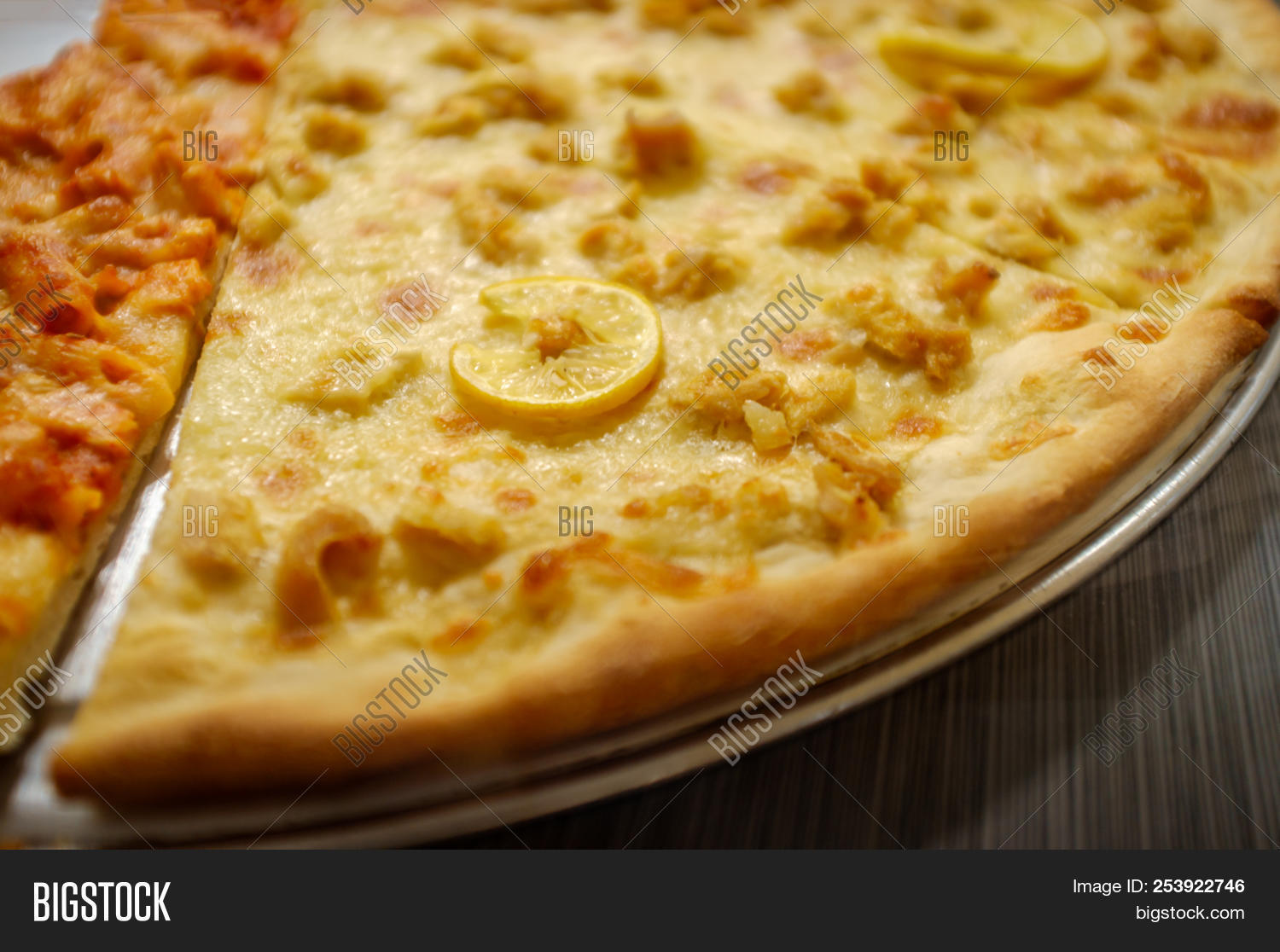 Large Slices Of Cheese Pizza With Chicken Francese Topping
