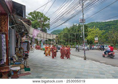 Cheerful Women In National Dress Walking Down The Street April 11, 2018 Pokhara, Nepal.