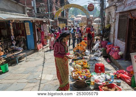 On The Street Leading To The Pashupatinath Temple Woman Chooses Decorations 13 April 2018, Kathmandu
