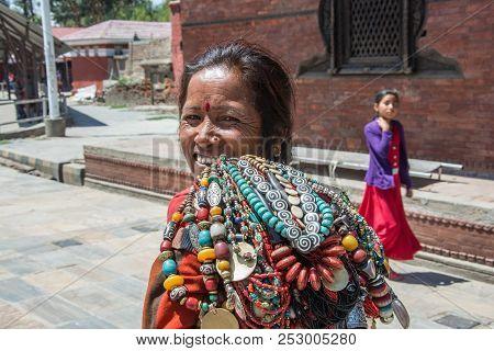 Kathmandu, Nepal-13.04.2018: An Elderly Woman Sells Jewellery On 13 April 2018 To Kathmandu, Nepal.
