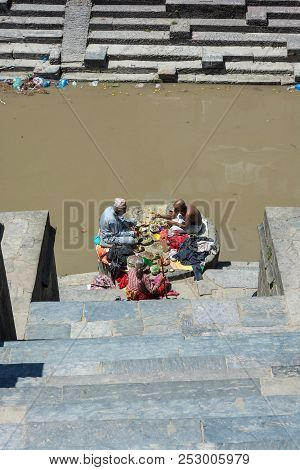 Two Men And A Woman Eating On The Banks Of The Bagmati River In The Pashupatinath Temple 13 April 20