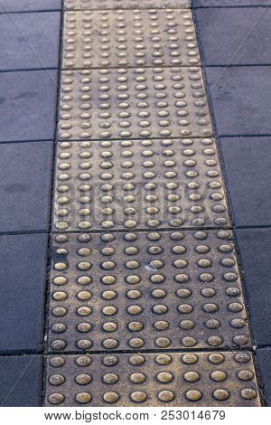 Braille Block On The Sidewalk For The Visually Impaired.