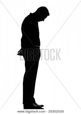 one caucasian business man sad lonely silhouette standing Full length in studio isolated on white background