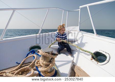 Travelling Concept. Little Child Enjoy Travelling On Ship. Baby Boy Travelling By Sea. Travelling On