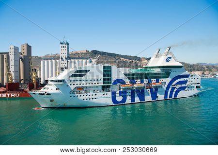Barcelona, Spain - March 30, 2016: Ship Or Liner Gnv Rhapsody Genova In Sea Harbor On Mountain Lands
