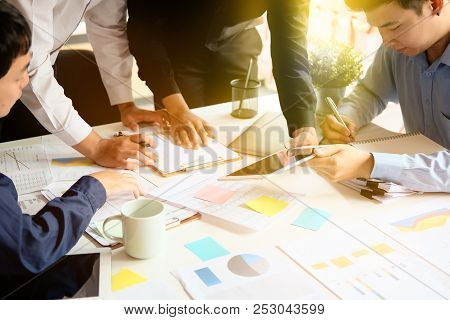 Close-up On Discussion.asian Businessman Meeting To Analyze And Discuss The Situation On The Financi