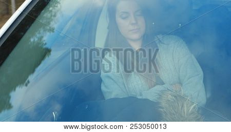 Pretty young woman sleeping in car