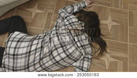 Unconscious or dead woman lying on floor.