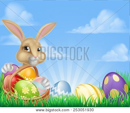 Easter Scene With Easter Bunny With A Basket Full Of Decorated Chocolate Easter Eggs In A Field