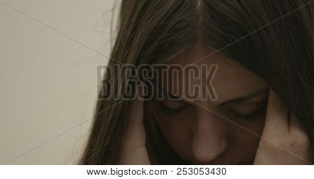 Woman with headache and a hand on forehead