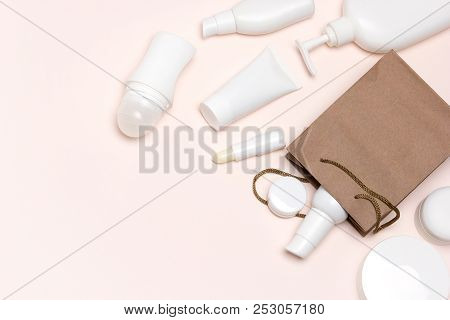 Cosmetic Products With Paper Merchandise Bag. Beauty Shopping Concept With Copy Space, Flat Lay