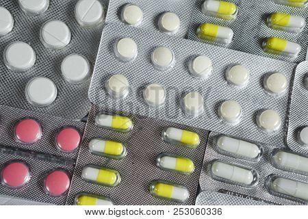 Pharmaceuticals Antibiotics Pills Medicine. Colorful Antibacterials Pills On White Background. Capsu