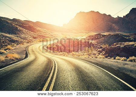 Retro Toned Scenic Desert Road At Sunset, Travel Concept, Usa.