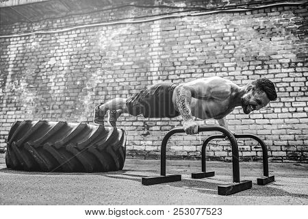 Strong Sporty Shirtless Man Doing Press Exercises Holding Plank Outdoors. Push Up From Bar. Outdoor