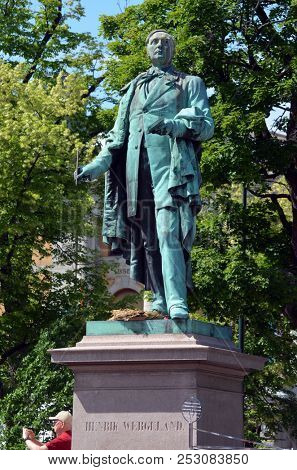 View of the monument to Henrik Wergeland, famous Norwegian writer, poet, playwright, polemicist, historian, and linguist  near the National Theater. June 17,2018. Oslo,Norway