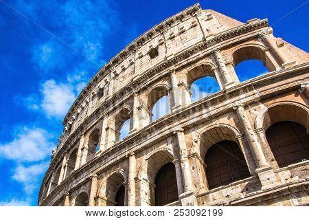 Rome, Italy - September 12, 2017: Colosseum In Rome Against Blue Sky. Rome Architecture And Landmark