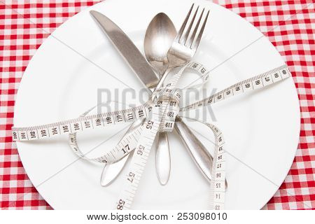 Weight Loss Weight Loss Concept Diet Empty Plate With A Tape Measure And Cutlery