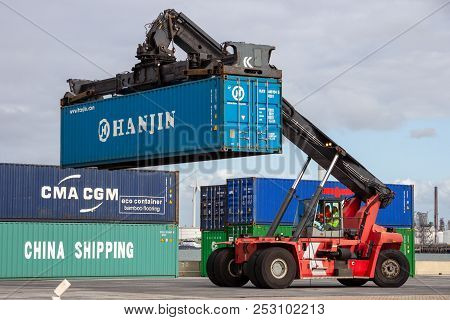Rotterdam, Netherlands - Sep 6, 2015: Mobile Container Handler In Action At A Container Terminal In