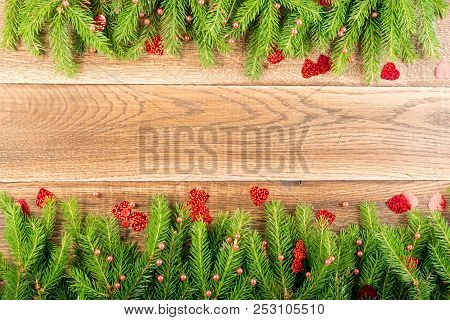 Christmas Background With Fir Branches On Wooden Backdrop Flat Lay