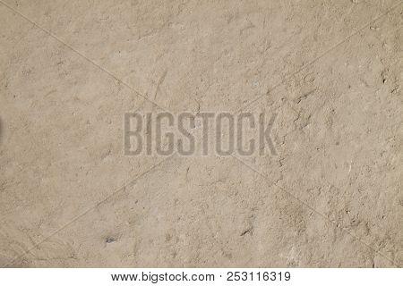 Arid Soil Background. Natural Texture Of Desert Earth