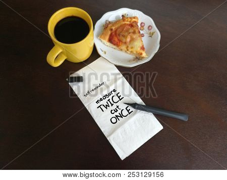 Measure twice and cut once, written on napkin paper