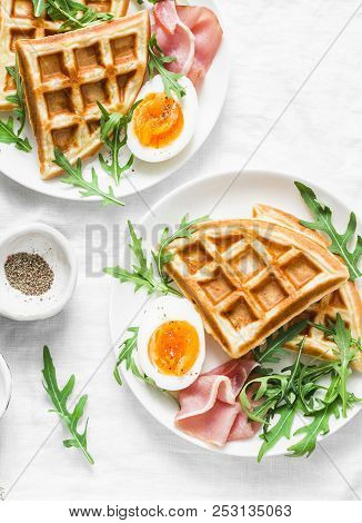 Savory Waffles, Boiled Egg, Ham And Arugula On Light Background, Top View. Appetizers, Snack, Brunch