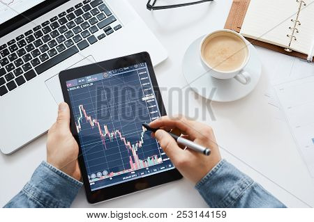 Investor Watching The Change Of Stock Market On Tablet