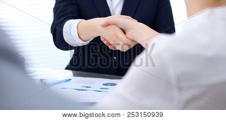 Group Of Business People Shaking Hands While Finishing Up A Meeting. Handshaking, Agreement Or Succe