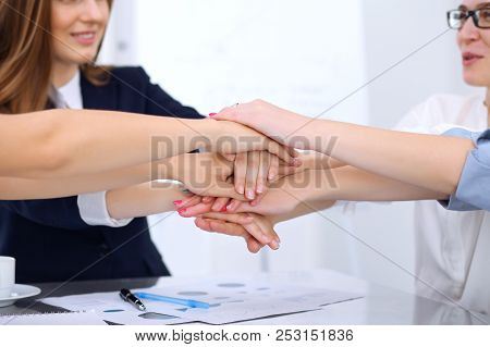 Group Of Business People Joining Hands, Close-up. Teamwork, Cooperation And Success Concept Of Commu