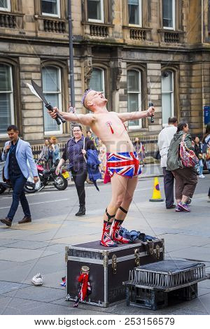 Edinburgh, Scotland  - August 7: Busker Spikey Will Calling To The Crowd At The Edinburgh Fringe Fes