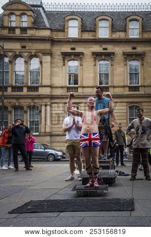 Edinburgh, Scotland  - August 7: Street Performer Spikey Will Flexing At The Edinburgh Fringe Festiv