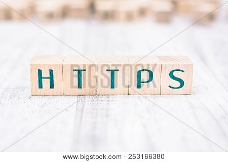 The Word Https Formed By Wooden Blocks On A White Table