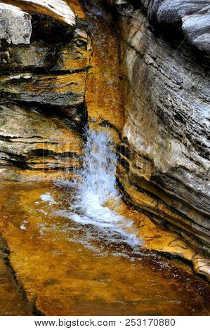Rocky Wall And Ledges Guide Cascading Water In The Ozark Mountains Of Arkansas.