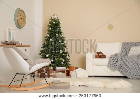 Stylish Living Room Interior With Decorated Christmas Tree