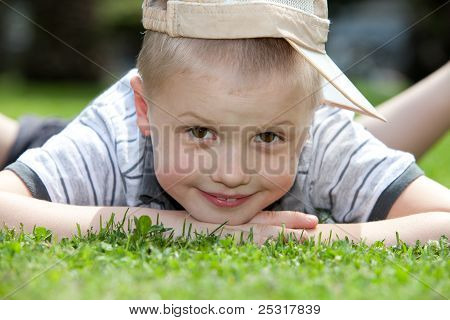 happy child lying on the grass