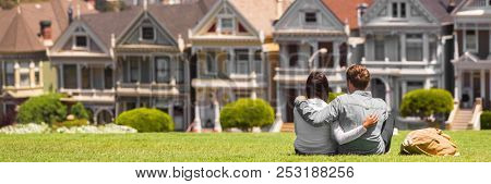 San Francisco travel tourists couple looking at houses landscape banner. First real estate buyers looking to buy a home, homeowner concept. Background of neighborhood.