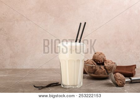 Glass With Delicious Milk Shake On Table