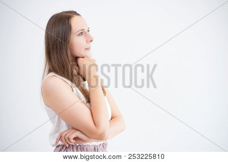 Serious Pensive Young Woman Leaning Head On Hand And Looking Into Distance. Thoughtful Girl Contempl