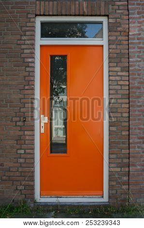 A Bright Orange Door In  The Netherlands