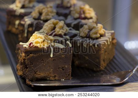 Chocolate Cake With The Walnut And Berries