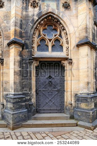 Prague, Czech Republic, Jun 9, 2018: View Of An Ornate Entrace Door In Gothic Style Architecture At